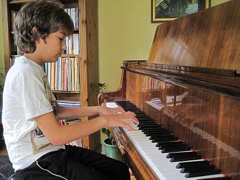 Image of Paul practising piano in Pinner