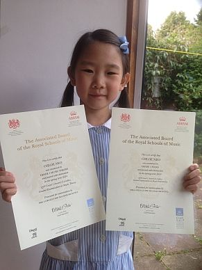 Photo of Chloe with her certificates