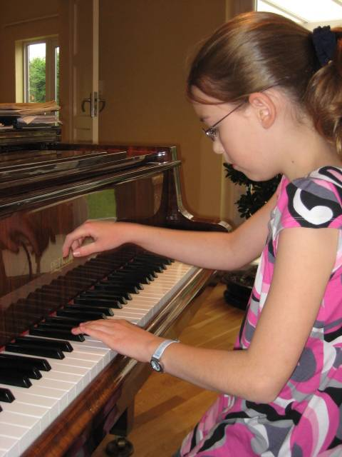 Girl at piano lesson in Pinner