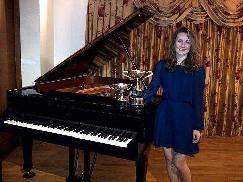 Image of piano student in Pinner with her piano trophies