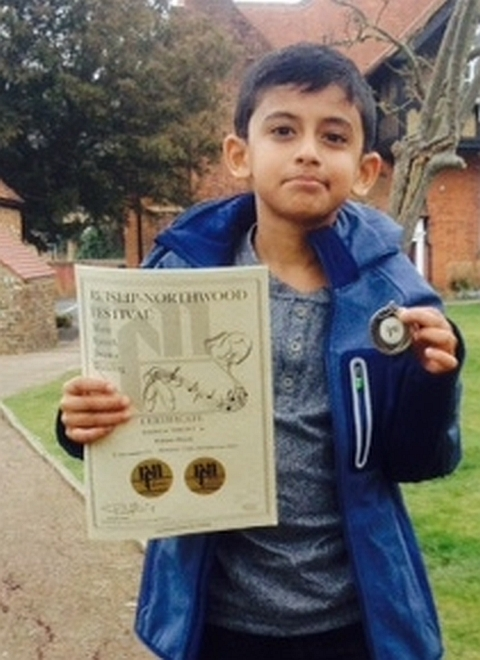 Image of piano student in Pinner with Ruislip-Northwood piano certificate.