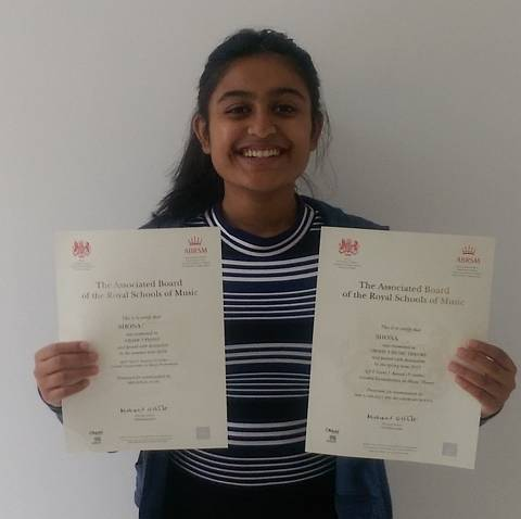 Image of shona with her certificates