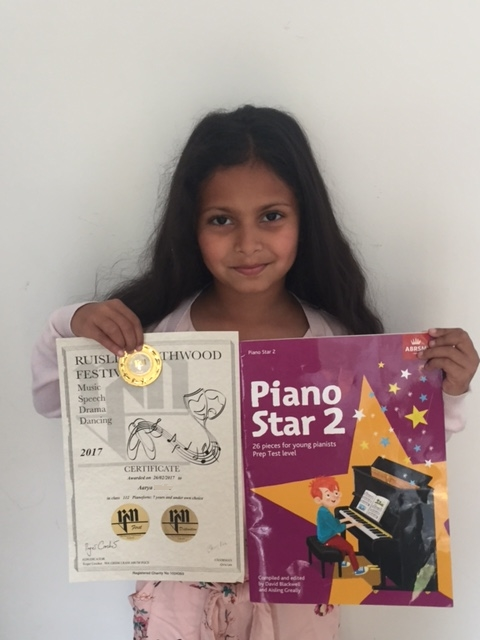 Piano student from pinner with Piano Star book and certificate