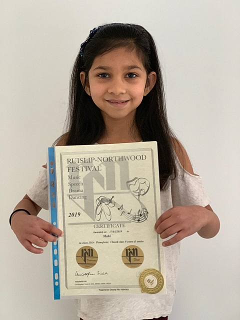 Image of Mahi from Pinner with her piano certificate